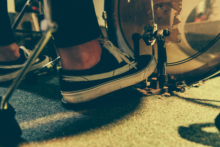 cropped view of man in sneakers pressing bass pedal Imagens
