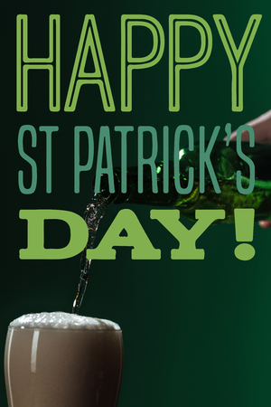 beer pouring into glass with happy st patricks day lettering on green background
