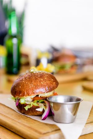 selective focus of burger on cutting board with copy space Stock Photo