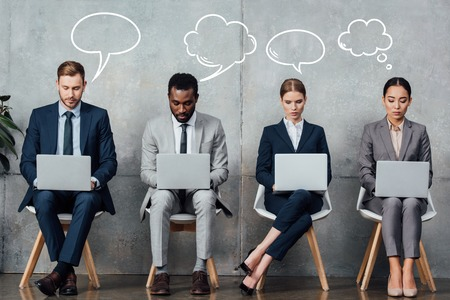 multiethnic businesspeople sitting on chairs and using laptops in waiting hall with empty speech and thought bubbles illustration above heads