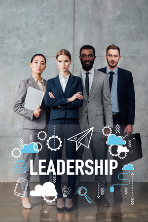 focused multiethnic group of businesspeople in formal wear posing and looking at camera with leadership illustration in front Reklamní fotografie