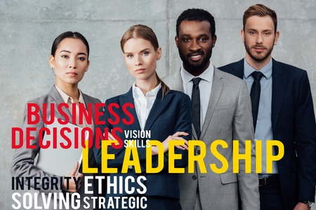 focused multiethnic group of businesspeople in formal wear posing and looking at camera with leadership illustration in front Stock fotó