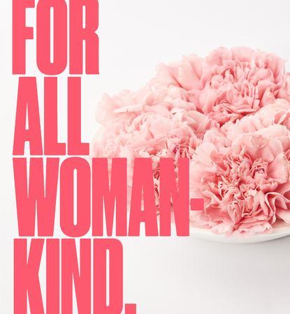 close up of pink carnations in plate on white background with for all woman kind lettering