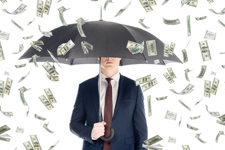 businessman in suit with obscure face and umbrella under money rain Stock fotó