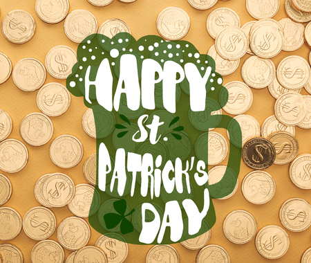 top view of shiny golden coins with dollar signs near happy st patrick day lettering on orange background Stock Photo