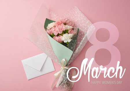top view of pink and white carnations bouquet with envelope on pink background and 8 march illustration