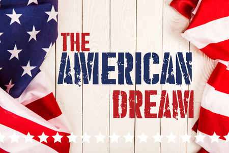 top view of american flags and the american dream lettering on white wooden surface