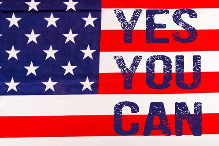 blue yes you can lettering on american flag Stock Photo