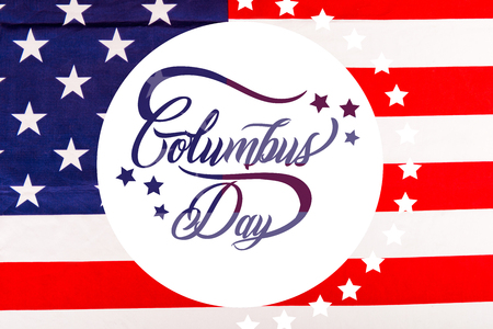 Columbus day lettering in white circle on american flag with stars Stock Photo