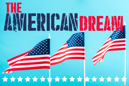 american flags with the american dream lettering and stars on blue Imagens