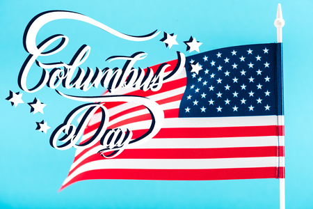 american flag with Columbus day lettering and stars isolated on blue