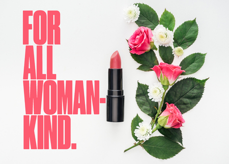 top view of flower composition, pink lipstick and for all woman kind lettering on white background Stock Photo