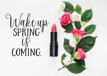 top view of flower composition, pink lipstick and spring illustration on white background
