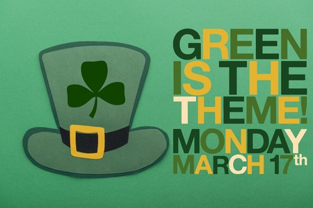 green irish paper hat near lettering on green background