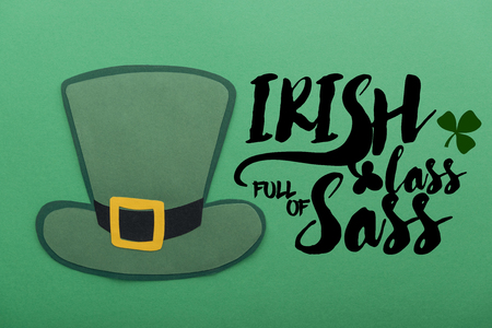 paper hat near irish lass full of sass lettering on green background