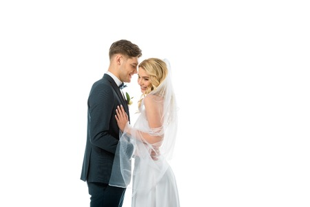 happy bridegroom talking to beautiful smiling bride isolated on white