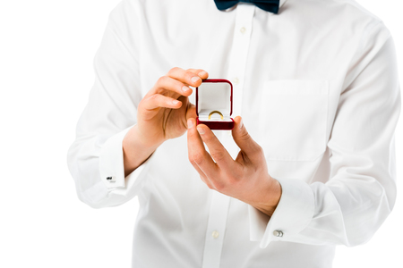 selective focus of groom showing gift box with wedding ring isolated on white Stock Photo - 120048350