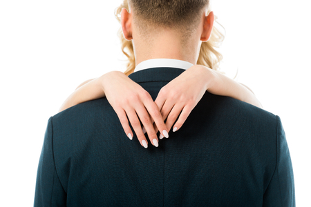 back view of groom hugged by bride isolated on white 스톡 콘텐츠