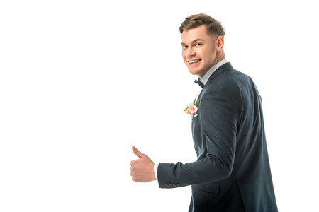 handsome smiling bridegroom showing thumb up isolated on white Stock Photo