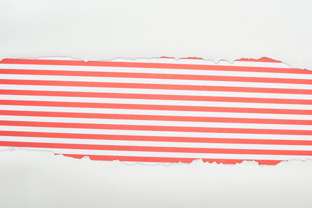 ragged white textured paper with copy space on red striped background 스톡 콘텐츠 - 120050106