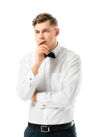 thoughtful bridegroom holding hand near face isolated on white Stock Photo - 120051240