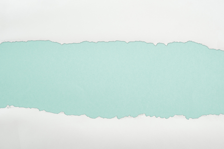 ragged and white paper with copy space on light blue background