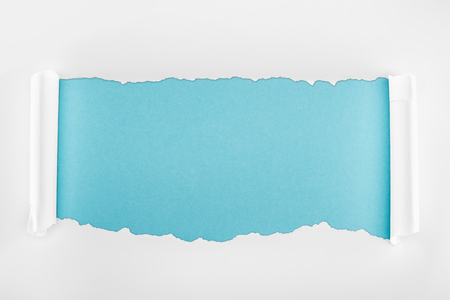 ripped white paper with curl edges on light blue background
