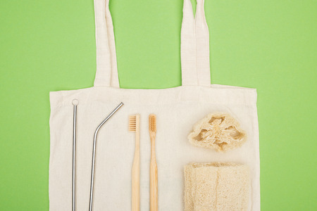 stainless steel straws, organic bamboo toothbrushes and loofah on cotton bag