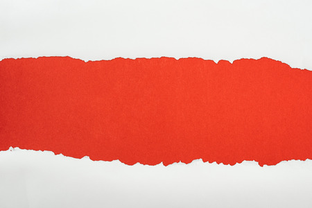 ripped white textured paper with copy space on red background