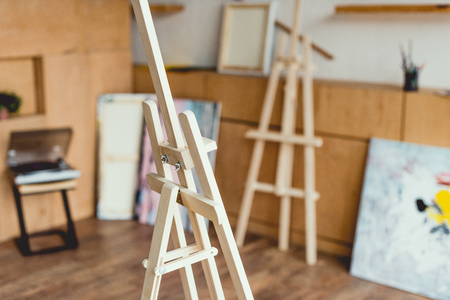 selective focus of wooden easel in painting studio