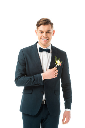 happy handsome groom in black suit looking at camera isolated on white Stock Photo