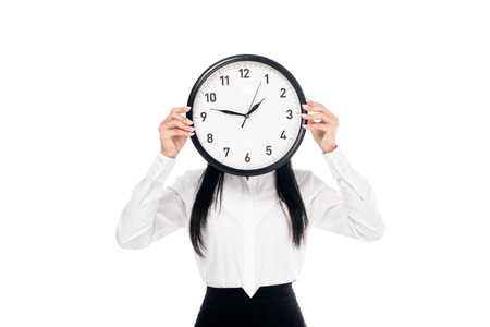 Brunette businesswoman in shirt holding clock isolated on white