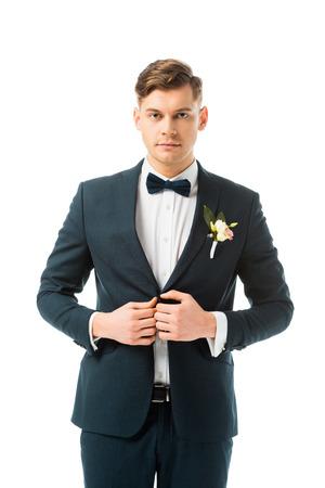serious bridegroom in elegant black suit isolated on white
