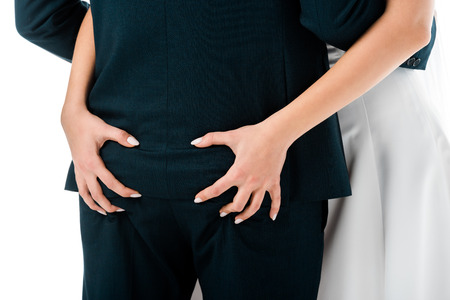 partial view of woman squeezing male butt isolated on white Stock Photo - 120136753
