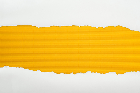 ripped white textured paper with copy space on yellow striped background Imagens