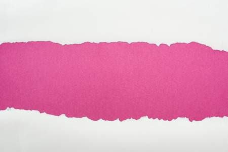 ripped white textured paper with copy space on crimson background Stock Photo