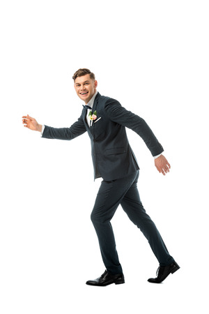 tricky cheerful bridegroom imitating running away isolated on white Stock Photo