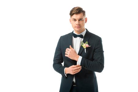 confident handsome bridegroom in black elegant suit isolated on white