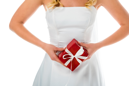 cropped view of bride holding red gift box isolated on white