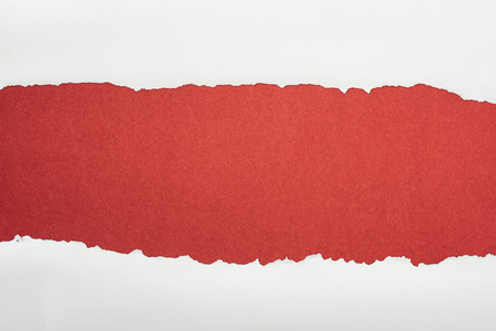 ragged white textured paper with copy space on burgundy background