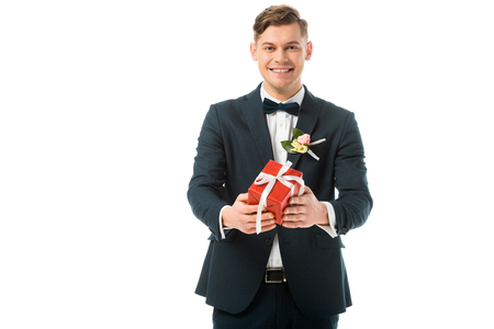 happy bridegroom holding red gift box isolated on white