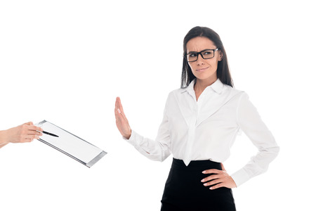 Dissatisfied businesswoman in glasses refusing to sign contract isolated on white