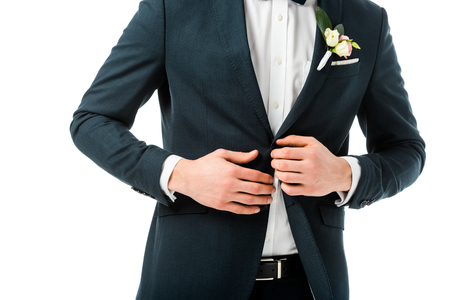cropped view of bridegroom in elegant black suit with boutonniere isolated on white
