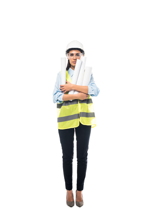 Full length view of engineer in hardhat and goggles holding blueprints isolated on white