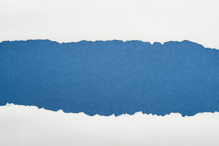 ragged white textured paper with copy space on deep blue background 스톡 콘텐츠 - 120056778