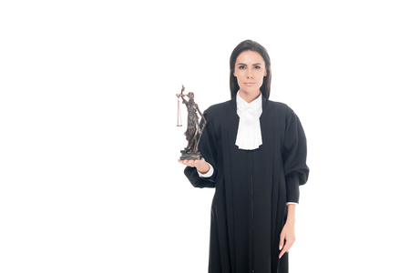 Judge in judicial robe holding themis figurine isolated on white Stock Photo