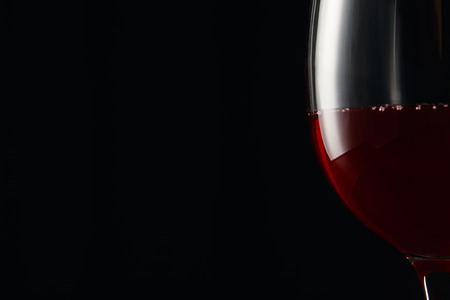 Glass with burgundy red wine isolated on black 스톡 콘텐츠