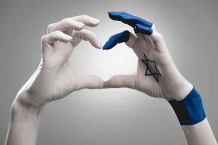 cropped view of female hands with blue star of david showing heart on grey Stock fotó - 119772905