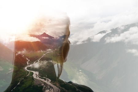 Double exposure of girl and mountains in clouds Stock fotó - 119773317