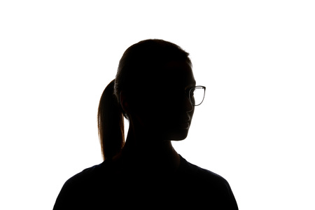 Silhouette of woman in glasses looking away isolated on white